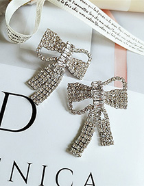 Fashion White Pierced Bow Earrings With Diamonds