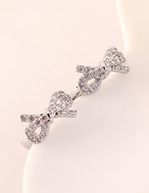 Fashion Platinum Cutout Small Bow Earrings With Diamonds
