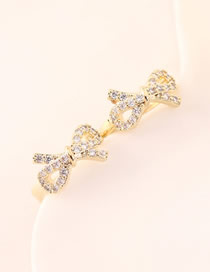 Fashion 14k Gold Cutout Small Bow Earrings With Diamonds