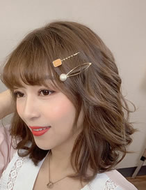 Fashion Yellow Hollowed With Pearl Twist: Dripping Oil Hairpin: 2 Pieces.