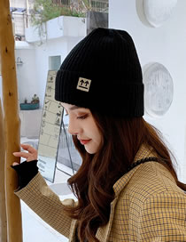 Fashion Black Solid Color Luminous Arrow Mark Knitted Curled Beanie