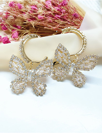 Fashion White Diamond Butterfly Alloy Hollow Earrings
