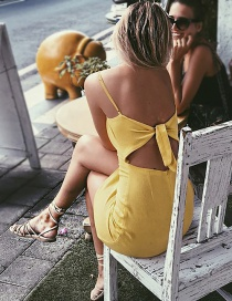 Sexy Yellow Pure Color Decorated Backless Condole Sandbeach Dress